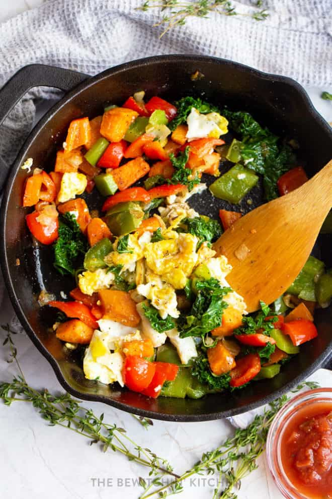 scrambled egg skillet with sweet potatoes, kale, and bell peppers