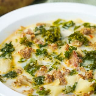 bowl full of a creamy sausage and kale soup