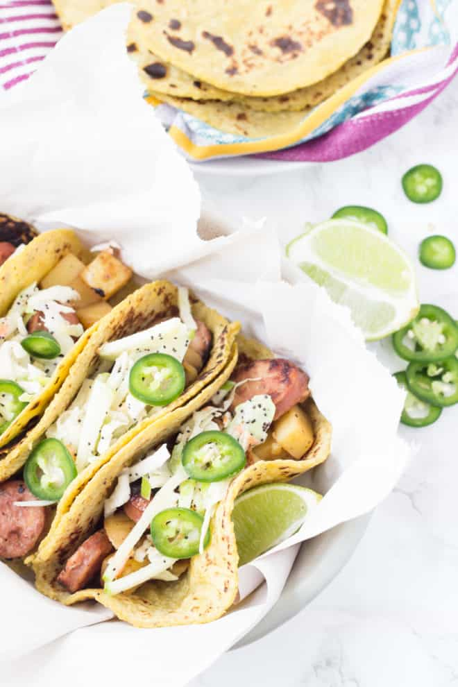 sausage hash in tortillas with zesty apple slaw topped with jalapenos