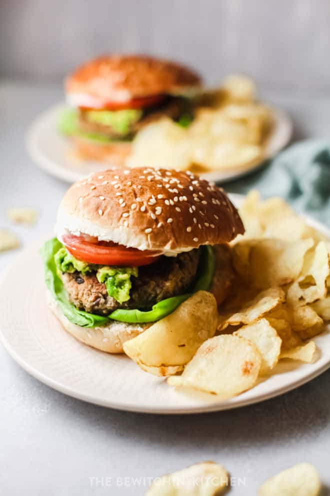 plant based black bean burgers served with guacamole and chips