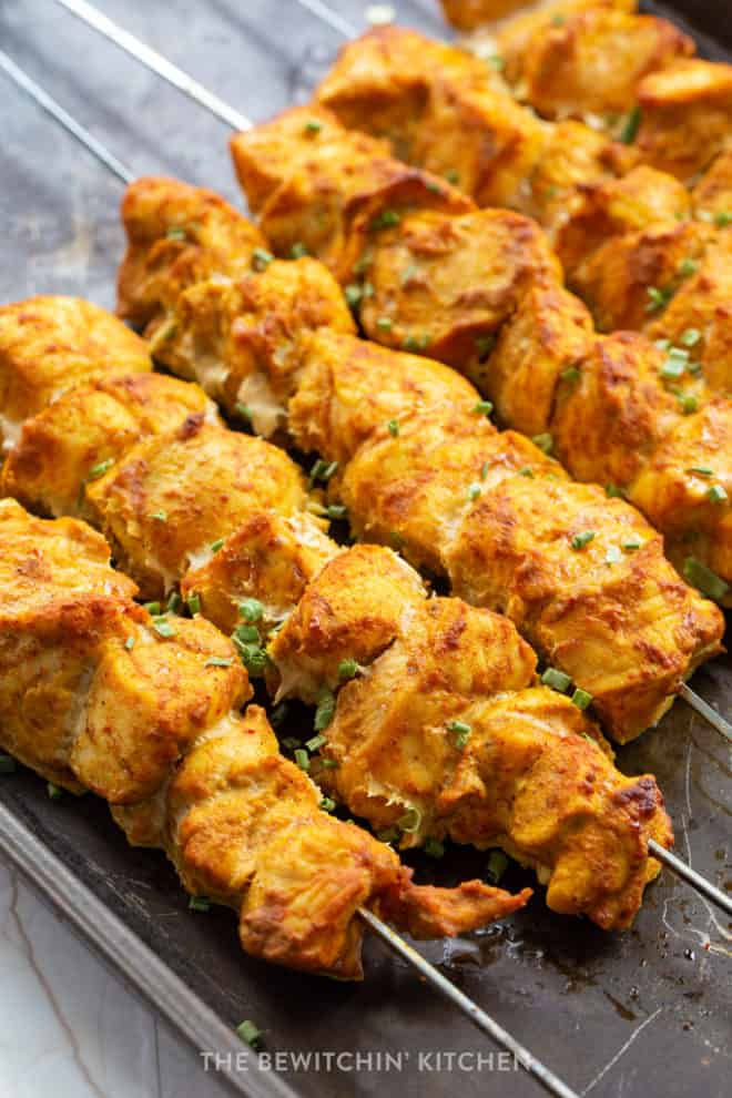 baked chicken kebabs on a baking sheet