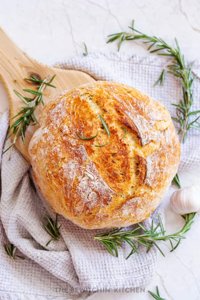 A fresh loaf of homemade bread baked in a dutch oven