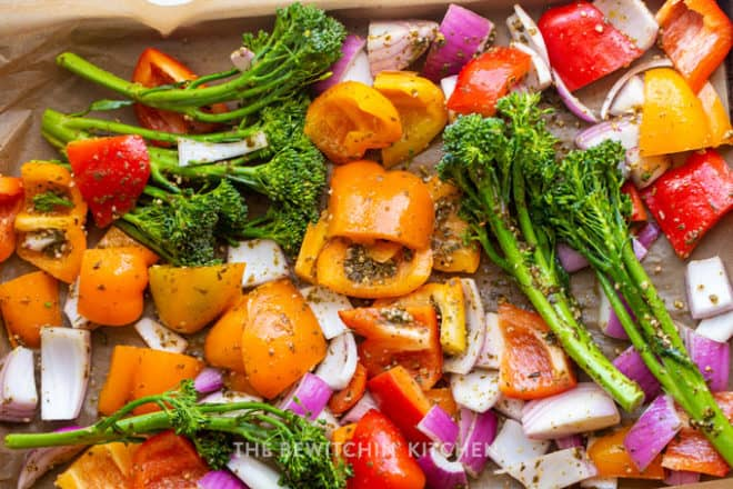 roasting vegetables: broccolini, red onion, and bell peppers